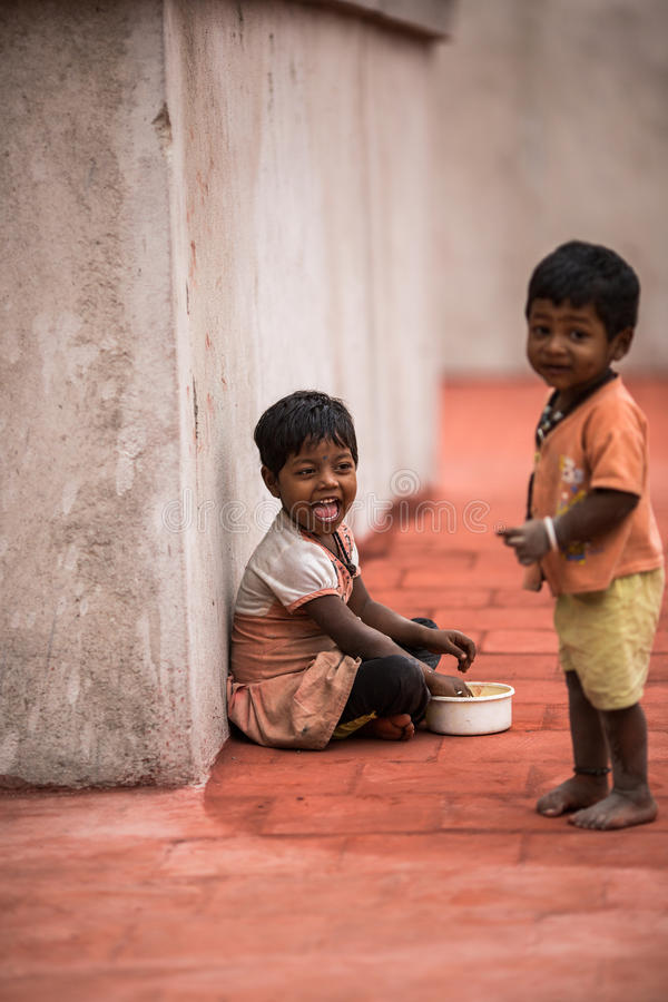 Indian kid. Playing in the street royalty free stock photo
