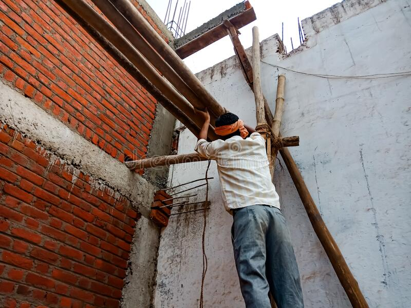 an indian labour making wooden structure for wall construction in india January 2020 royalty free stock images