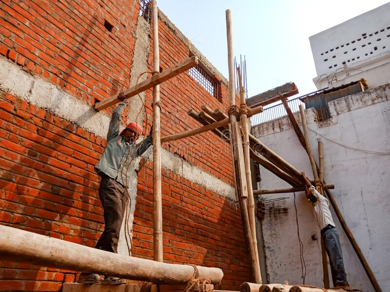indian labour making wooden structure for wall construction in india January 2020 stock photography