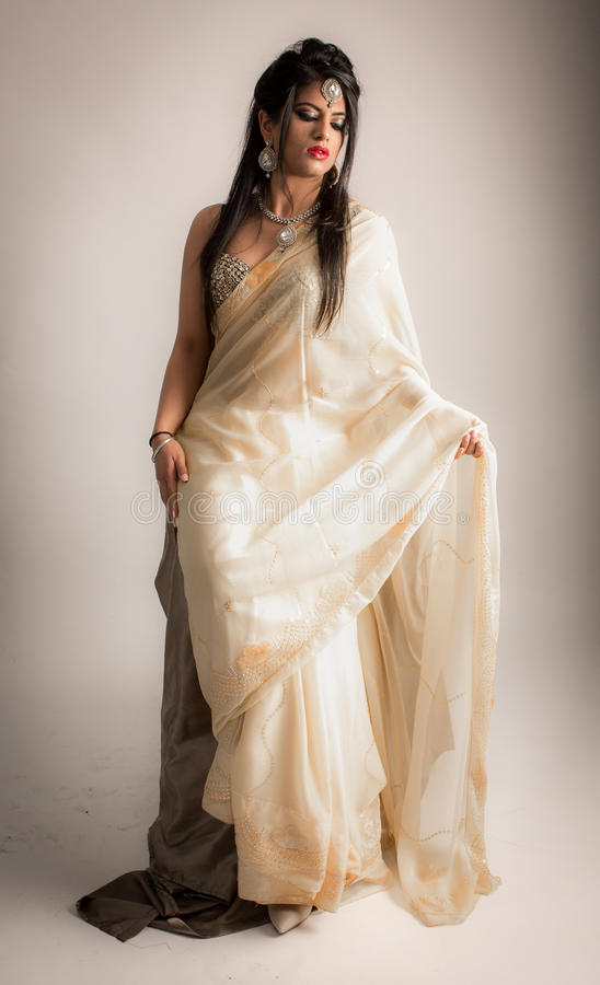 Beautiful Indian lady female model in cream white dress stock photos