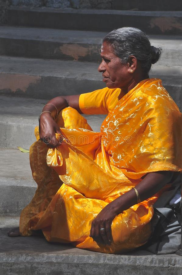 Indian lady in a golden sari stock photography