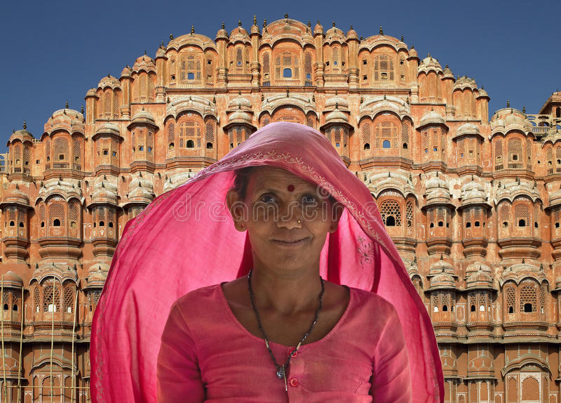 Indian lady - Palace of the Winds - Jaipur - India. Indian lady wearing a Sari by the Palace of the Winds in Jaipur in Rajasthan in Northern India royalty free stock photography