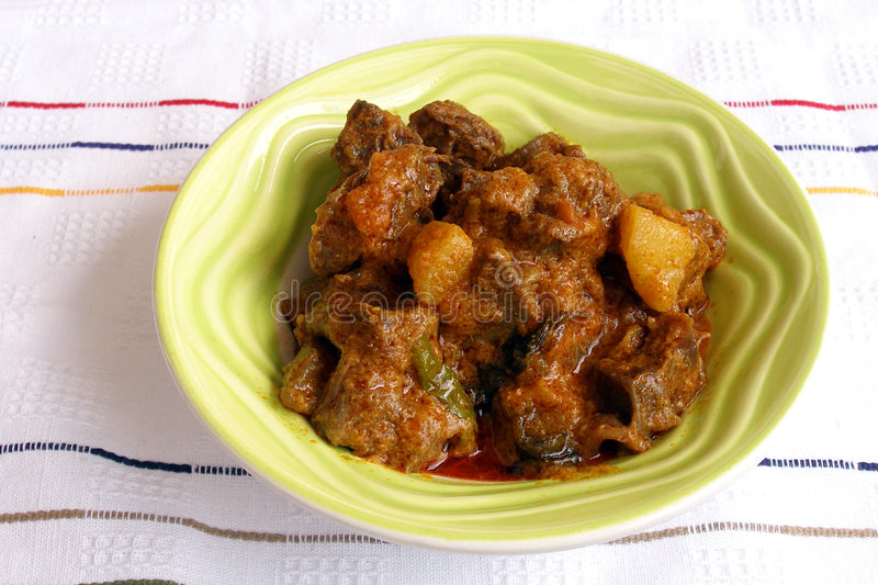 Indian lamb curry, spicy ethnic food. A dish of aromatic Indian spicy lamb or mutton curry, a well known dish cooked with indian spices. Stewed with potato and a stock photo
