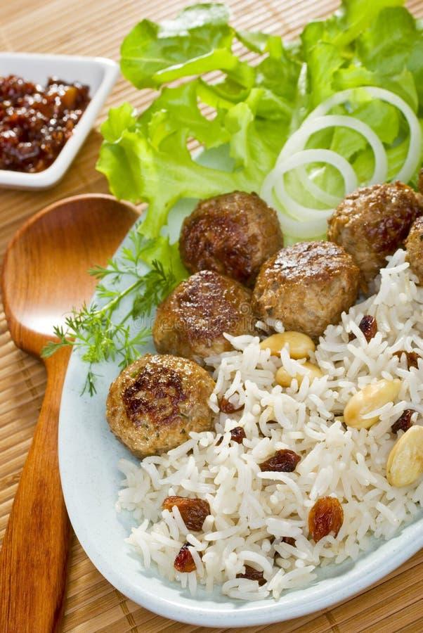 Indian Lamb Koftas and Pilau Rice stock images