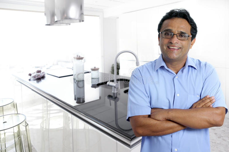 Indian latin man interior modern kitchen white royalty free stock images