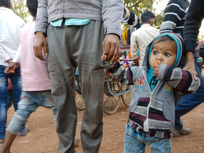 An indian little kid holded hand going to village fair program in India January 2020 stock photos