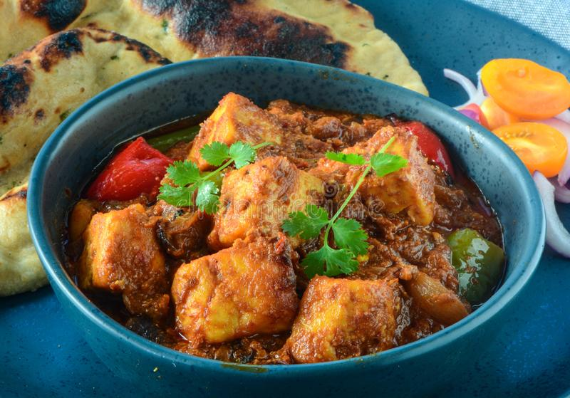 Kadai Paneer and tandoori roti. Indian main course for lunch or dinner- Kadai Paneer curry,roti,Indian flatbread and salad stock image