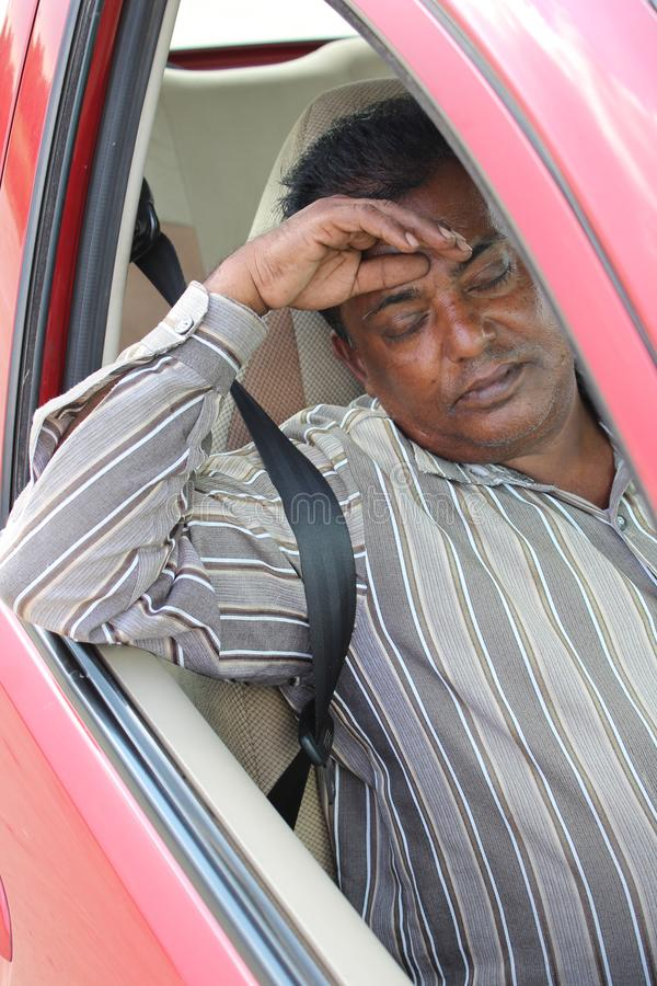 Tired Indian car driver stock photo