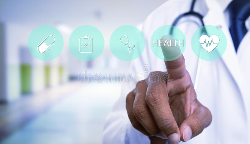 Doctor pressing invisible button with health text on screen. Indian male doctor close-up pressing green invisible circle button with health text on futuristic stock images