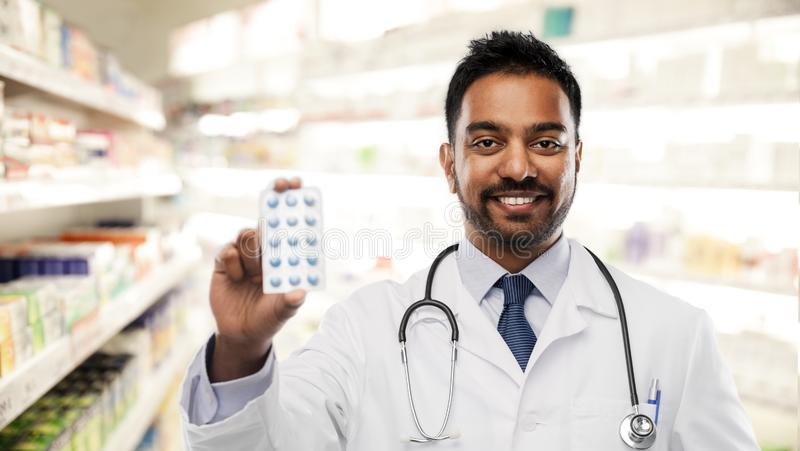 Indian male doctor or pharmacist with pills royalty free stock images