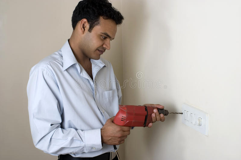Download Indian Man Drilling Hole In A Wall Stock Image - Image of isolated, look: 19164427