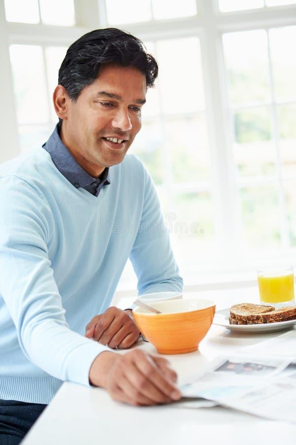 Indian Man Enjoying Breakfast At Home stock photo