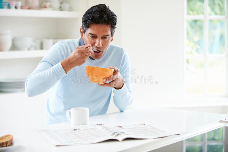 Indian Man Enjoying Breakfast At Home royalty free stock photography