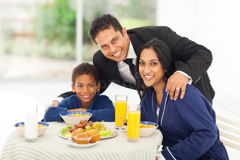 Indian man family. Portrait of happy indian men and family before leaving for work stock photography