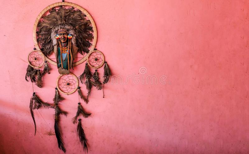 Indian man figure hanging on a wall.  stock photo