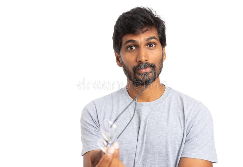 Man gesturing with eyeglasses or spectacles stock photos