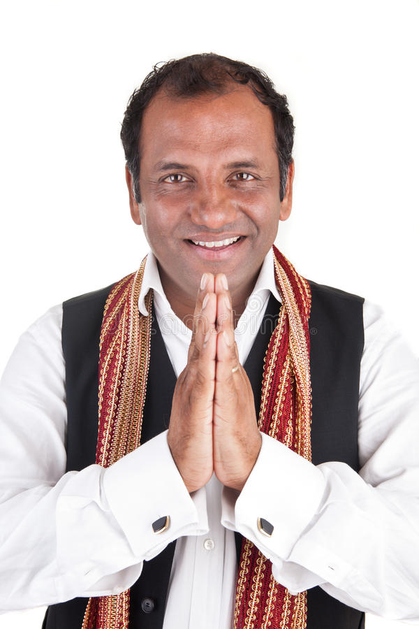 Indian man greets. Portrait of a Indian man that greets traditional royalty free stock photo