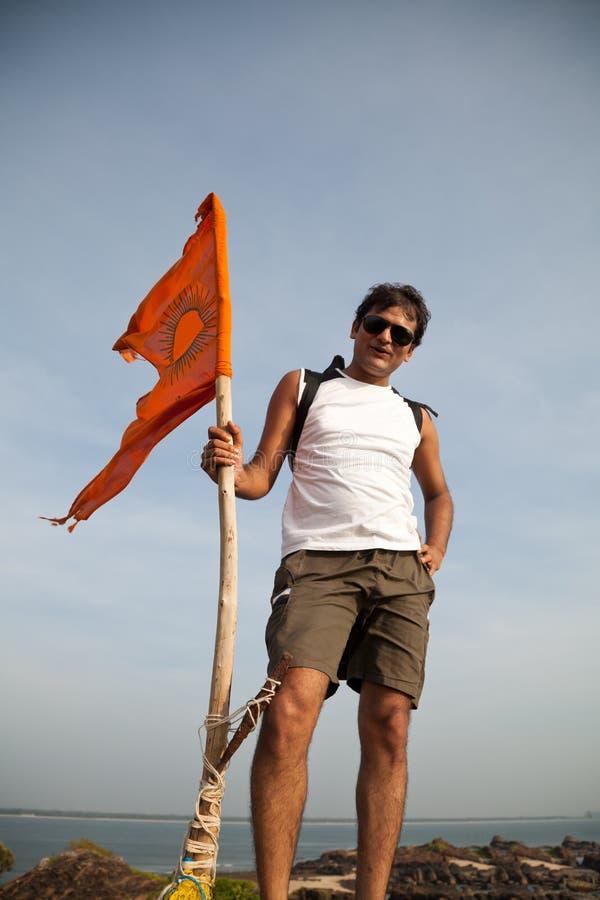 Indian man holding hindu flag stock images