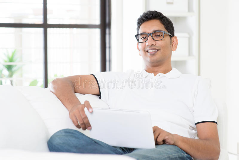 Indian man using digital computer tablet royalty free stock images
