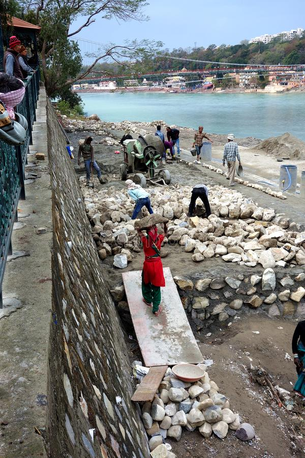 Indian Manual Laborers Building Stone Walls stock photo