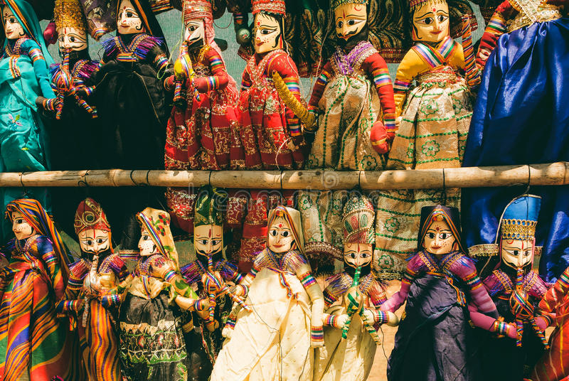 Indian market showcase with funny handmade dolls in traditional costumes. Marketplace with toys for children in India royalty free stock photo