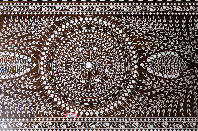 Indian marquetry panel with circular and floral pattern, part of a table royalty free stock image