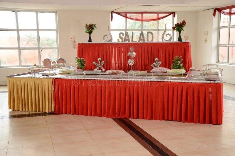 Indian Marriage Hall. An inside arrangement for food (salad and ice cream)in an Indian Marriage Ceremony Hall (Indoor settings royalty free stock images