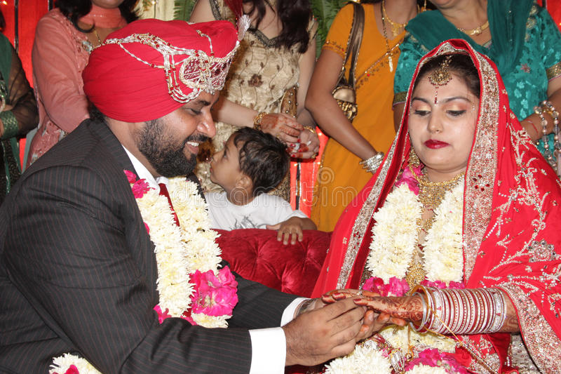 Indian Marriage ring ceremony. Ring ceremony of an indian punjabi sikh couple stock photo