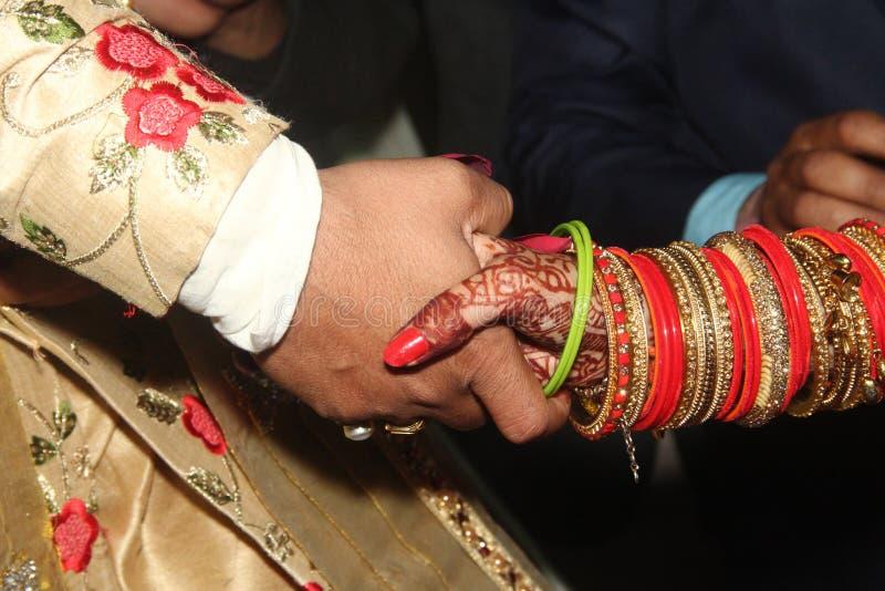 Hand shake of Indian couple. royalty free stock image