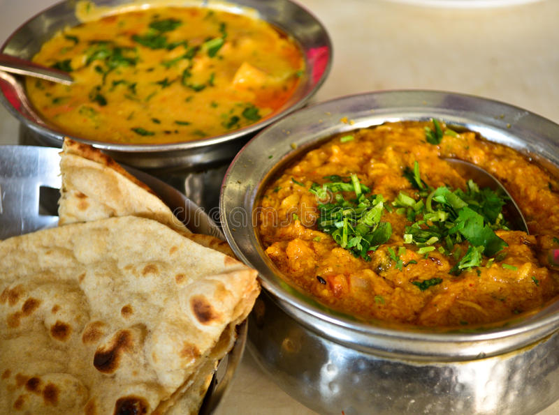 Indian vegetarian meal. Consisting of vegetable curry,lentils and Indian Bread stock photos