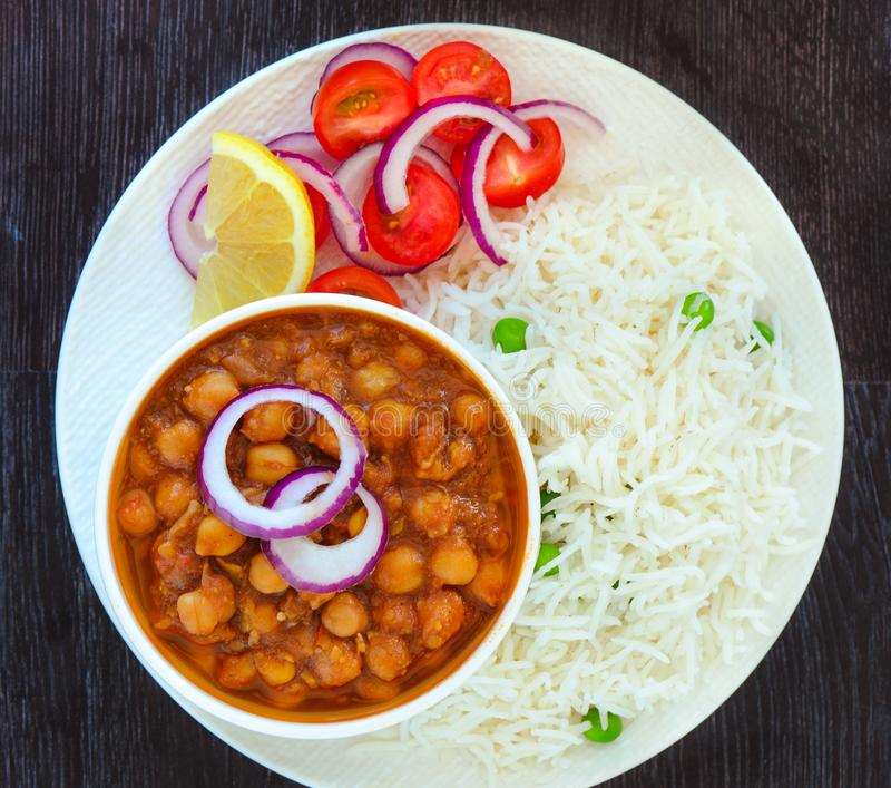 Indian meal -Chole masala and peas pulao. Indian meal-chole masala or channa masala and pilaf.Indian vegan gluten-free meal stock photography
