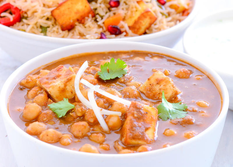 Indian meal -Chole Paneer and pilaf. Indian meal-chole paneer and pulao or biryani stock image