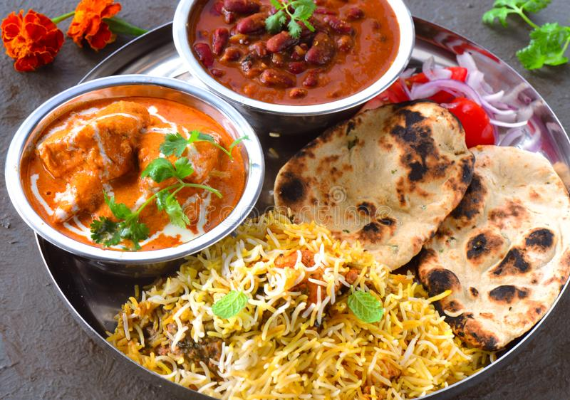 Indian non-vegetarian Meal -Butter Chicken, rajma, biryani with roti and salad stock images