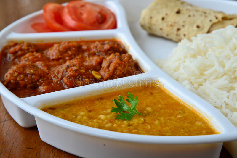 Indian meal. Consisting of Roti,rice,dal and vegetable kofta royalty free stock images