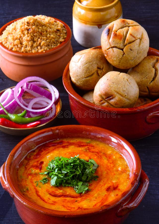 Free Indian Meal In Terracotta Pots -Dal Baati Churma Stock Photo - 158606440