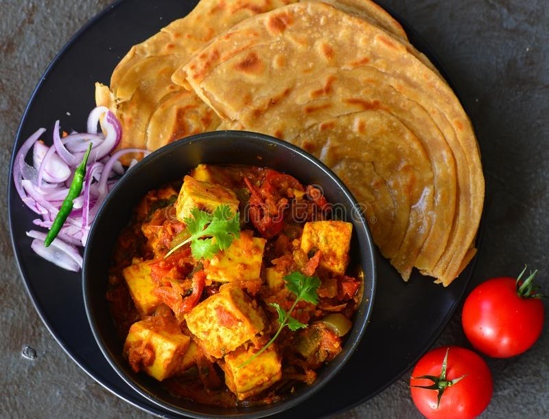 Indian meal-Kadai Paneer and lachcha paratha stock photography