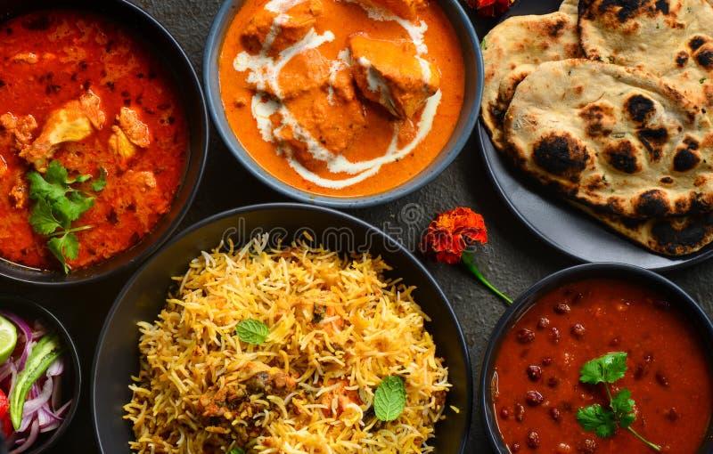 Indian party meal-non veg platter. Indian meal with tandoori roti ,bohri biryani,rajma masala,chicken tikka masala curry,butter chicken,Tandoori Roti and salad stock photography