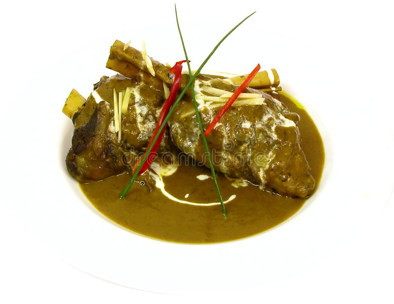Indian meat dish. Lamb shanks royalty free stock image
