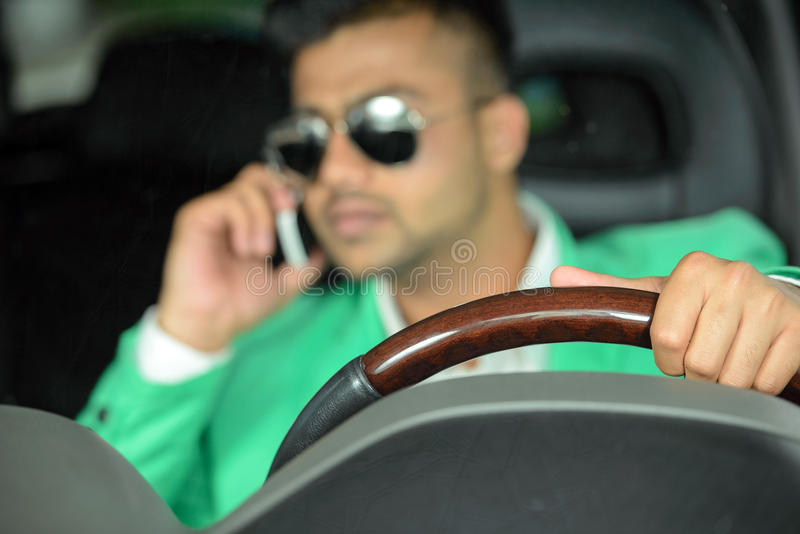 Indian Men. Portrait of young Indian business man, driving a car stock image