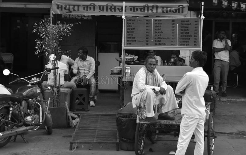 Indian men talking each other in morning in front of tea stall in pink city jaipur, India royalty free stock images