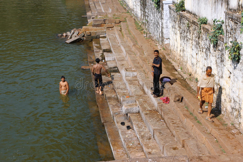 Indian men in a water pool stock photography