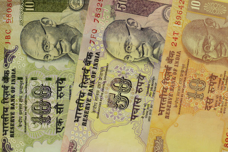 Indian money. Detail of several Indian banknotes royalty free stock photos