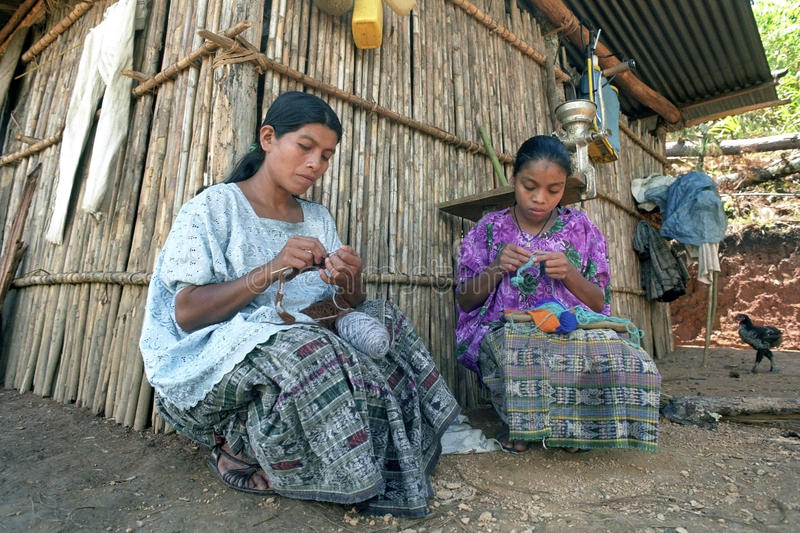 Indian mother and daughter sitting crocheting royalty free stock photo