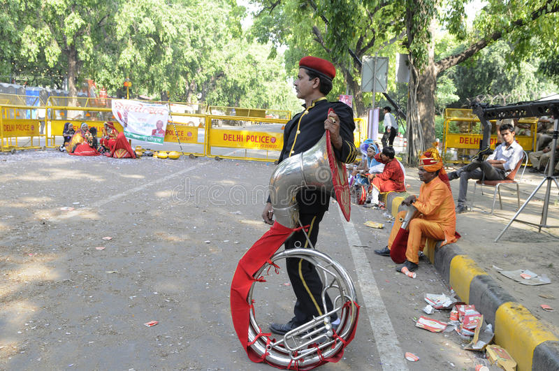 Indian music band. NEW DELHI-MAY 16: A musician standing alone in front of the BJP headquarter after a day long celebration of the wining the Indian National stock photo