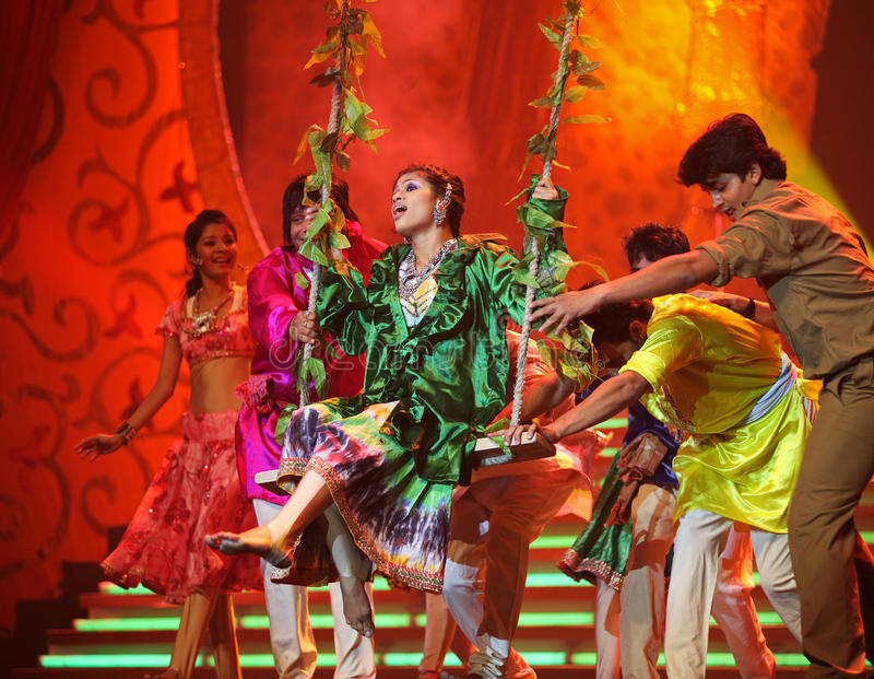 Indian Music and Dance Show. BEIJING – JANUARY 31: The Indian Bollywood Film Star Song and Dance Troupe perform on stage during Indian Music and Dance stock images