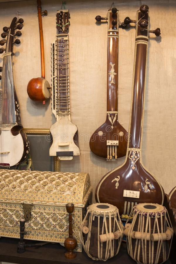 Indian musical instruments stringed guitars called sitars and Indian Folk percussion barrel shaped bass drums royalty free stock photo