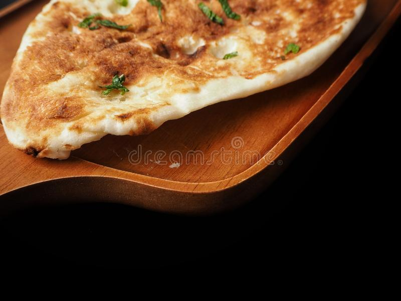 Indian naan bread on black background stock image