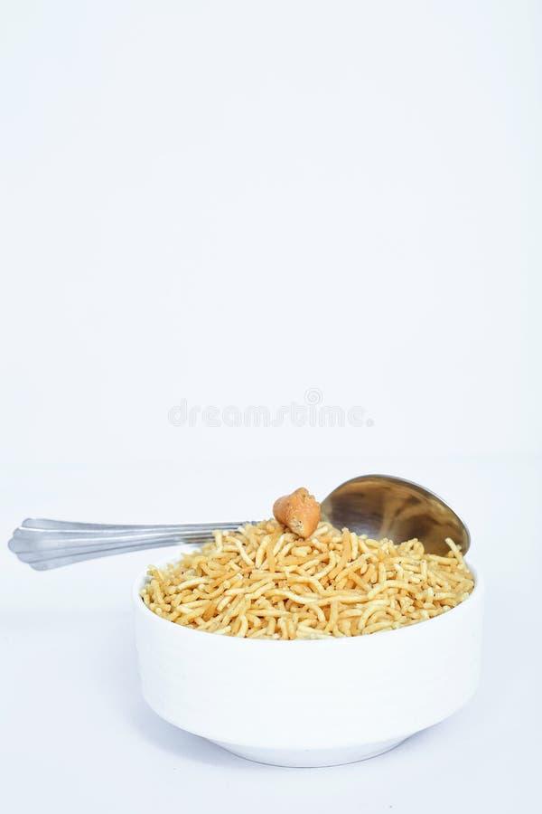 Indian namkeen bikaneri bhujia in the bowl royalty free stock image