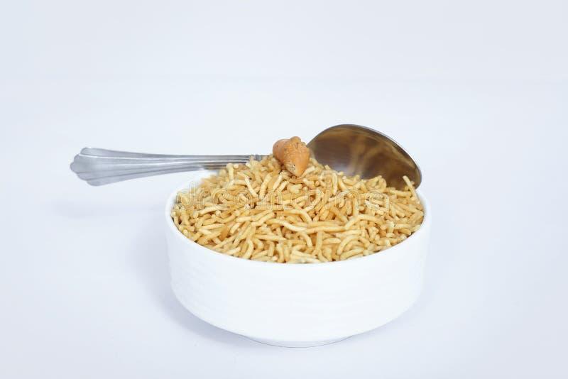 Indian namkeen bikaneri bhujia with spoon in the bowl royalty free stock image