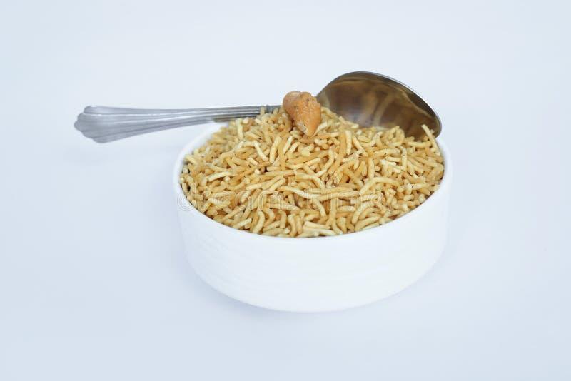 Indian namkeen bikaneri bhujia with spoon stock photo